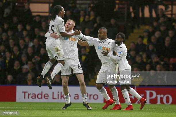 Jordan Ayew of Swansea City celebrates his goal with team mates Renato Sanches Oliver McBurnie and Nathan Dyer during the Premier League match...