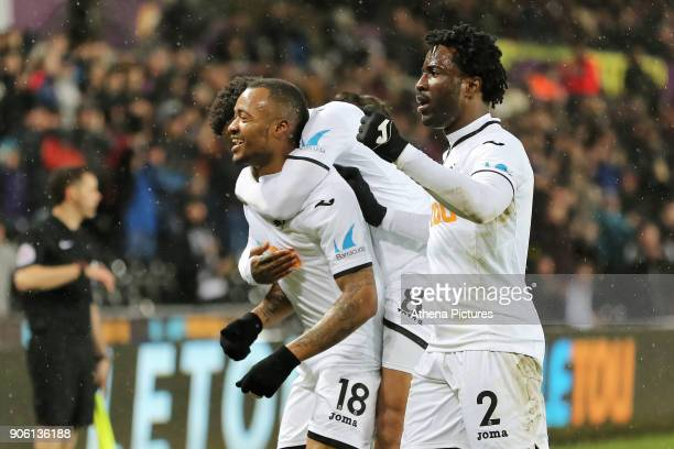 Jordan Ayew of Swansea City celebrates his goal with Wilfried Bony during the Emirates FA Cup match between Swansea and Wolverhampton Wanderers at...
