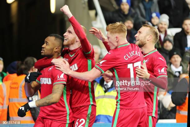 Jordan Ayew of Swansea City celebrates his opening goal with team mates Oliver McBurnie Sam Clucas and Mike van der Hoorn during the Premier League...