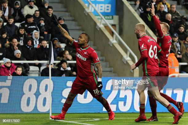 Jordan Ayew of Swansea City celebrates his opening goal with team mates Oliver McBurnie and Mike van der Hoorn during the Premier League match...