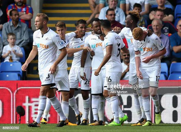 Jordan Ayew of Swansea City celebrates scoring his sides second goal with his Swansea City team mates during the Premier League match between Crystal...
