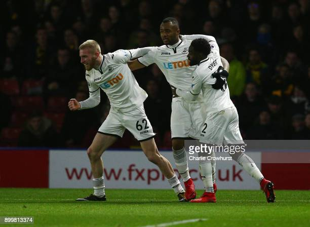 Jordan Ayew of Swansea City celebrates scoring his team's first goal with team mates during the Premier League match between Watford and Swansea City...