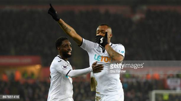 Jordan Ayew of Swansea City celebrates with Nathan Dyer after scoring his sides first goal during the Premier League match between Swansea City and...