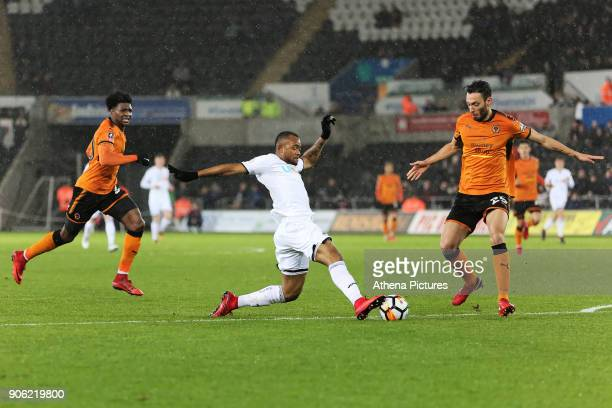 Jordan Ayew of Swansea City challenged by Roderick Miranda of Wolverhampton Wanderers during the Emirates FA Cup match between Swansea and...