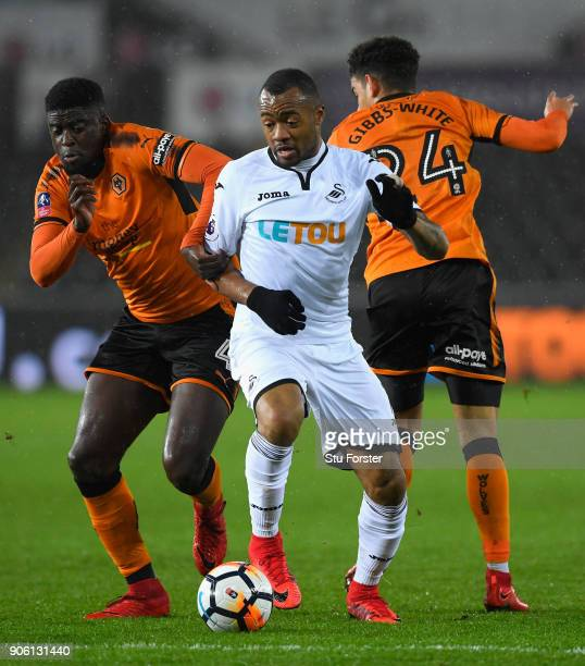 Jordan Ayew of Swansea City goes past Alfred N'Diaye of Wolverhampton Wanderers on his way to scoring his sides first goal during The Emirates FA Cup...
