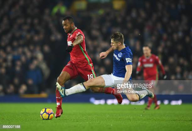 Jordan Ayew of Swansea City is challenged by Jonjoe Kenny of Everton during the Premier League match between Everton and Swansea City at Goodison...