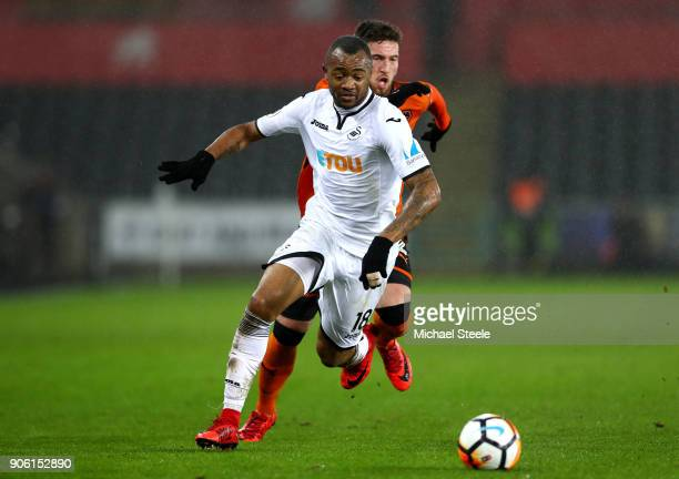 Jordan Ayew of Swansea City is closed down by Matt Doherty of Wolverhampton Wanderers during The Emirates FA Cup Third Round Replay between Swansea...