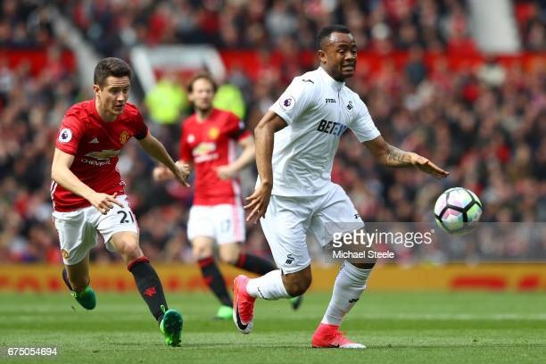 Jordan Ayew of Swansea City is put under pressure from Ander Herrera of Manchester United during the Premier League match between Manchester United...