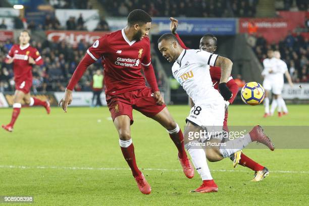 Jordan Ayew of Swansea City is tackled by Joe Gomez of Liverpool during the Premier League match between Swansea City and Liverpool at the Liberty...