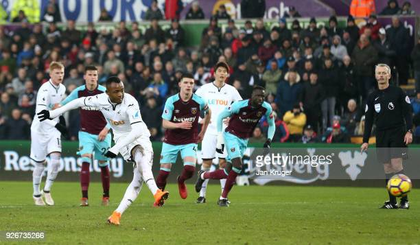 Jordan Ayew of Swansea City scores a penalty for his sides fourth goal during the Premier League match between Swansea City and West Ham United at...