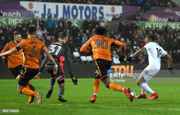 Jordan Ayew of Swansea City scores his sides first goal during The Emirates FA Cup Third Round Replay between Swansea City and Wolverhampton...