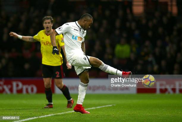 Jordan Ayew of Swansea City scores his team's first goal during the Premier League match between Watford and Swansea City at Vicarage Road on...