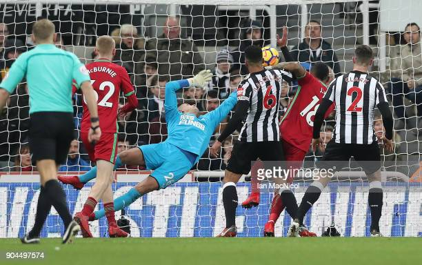 Jordan Ayew of Swansea City scores the opening goal during the Premier League match between Newcastle United and Swansea City at St James Park on...