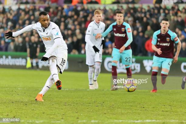 Jordan Ayew of Swansea City scores with a penalty during the Premier League match between Swansea City and West Ham United at The Liberty Stadium on...