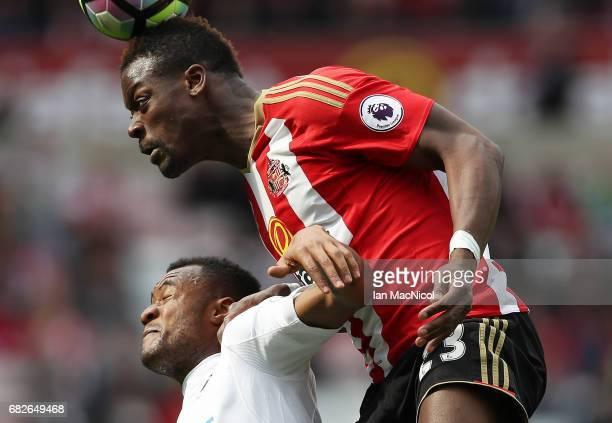 Jordan Ayew of Swansea City vies with Lamine Kone of Sunderland during the Premier League match between Sunderland and Swansea City at Stadium of...