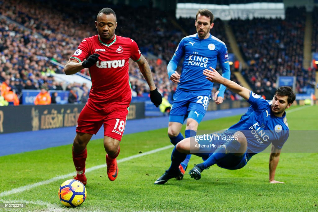 Jordan Ayew of Swansea is marked by Aleksandar Dragovic of Leicester City during the Premier League match between Leicester City and Swansea City at the Liberty Stadium on February 3, 2018 in Leicester, England.