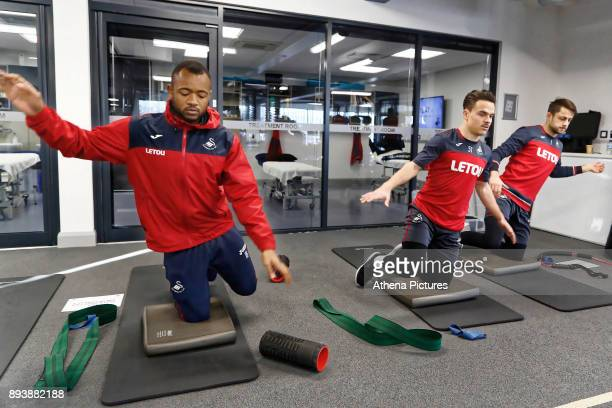 Jordan Ayew Roque Mesa and Lukasz Fabianski exercise in the gym during the Swansea City Training at The Fairwood Training Ground on December 15 2017...