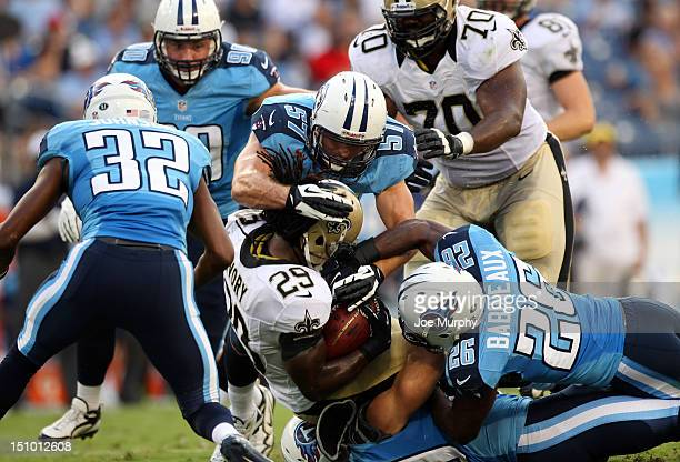 Jordan Babineaux and Patrick Bailey of the Tennessee Titans tackle Chris Ivory of the New Orleans Saints at LP Field on August 30 2012 in Nashville...