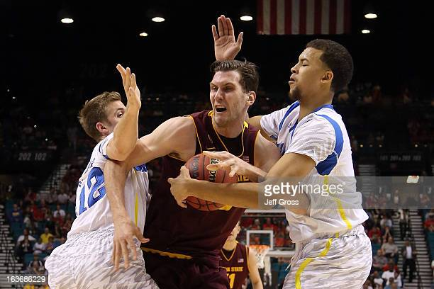 Jordan Bachynski of the Arizona State Sun Devils is doubleteammed by David Wear and Kyle Anderson of the UCLA Bruins in the first half during the...