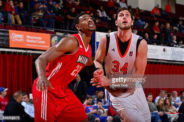 Jordan Bachynski of the Westchester Knicks boxes out Jordan Mickey of the Maine Red Claws at the Westchester County Center on November 12 2015 in...