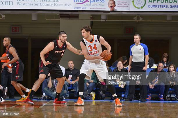 Jordan Bachynski of the Westchester Knicks handles the ball against Byron Mullens of the Sioux Falls Skyforce on November 20 2015 at the Westchester...