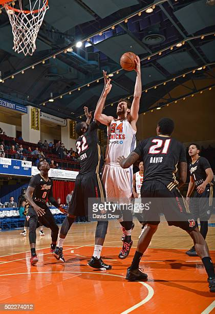 Jordan Bachynski of the Westchester Knicks shoots the ball against the Erie Bayhawks at the Westchester County Center on December 21 2015 in...