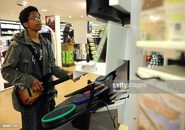 Jordan Balthard plays the Guitar Hero video game at a store in Paris France on Tuesday Sept 1 2009 Vivendi SA owner of the world's largest music...