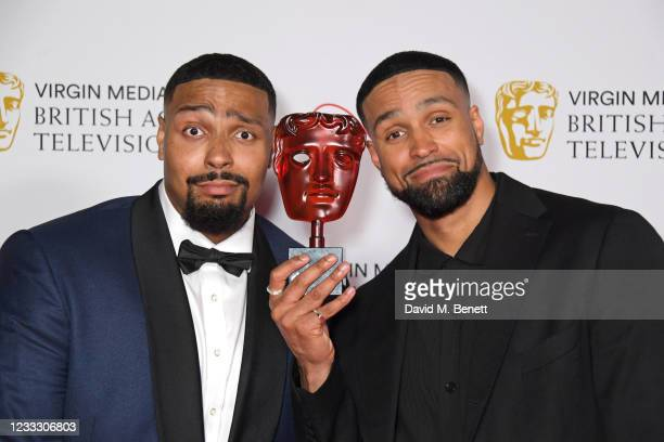 """Jordan Banjo and Ashley Banjo, accepting Virgin Medias Must-See Moment award for Diversity's performance on """"Britain's Got Talent"""", pose in the..."""