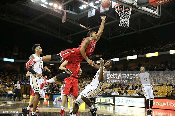 Jordan Barham of the Davidson Wildcats shoots the basketball over Daiquan Walker of the UCF Knights during an NCAA basketball game against the UCF...