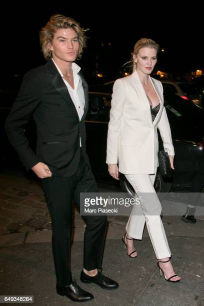 Jordan Barrett and Lara Stone arrive to attend the 'V Magazine' dinner at Laperouse restaurant on March 7 2017 in Paris France