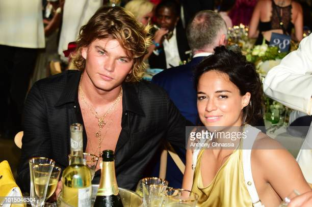 Jordan Barrett and Michelle Rodriguez attend the Unicef Summer Gala Presented by Luisaviaroma dinner at Villa Violina on August 10 2018 in Porto...