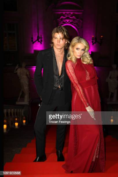 Jordan Barrett and Paris Hilton attend LuisaViaRoma and Naked Heart Foundation Dinner on January 09 2019 in Florence Italy