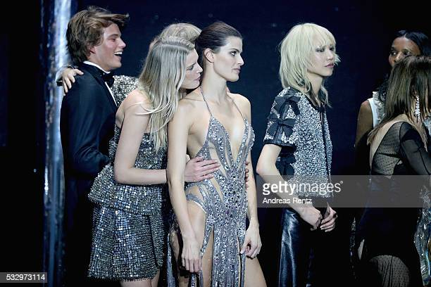 Jordan Barrett Lily Donaldson Isabeli Fontana and Soo Joo Park appear on stage at the amfAR's 23rd Cinema Against AIDS Gala at Hotel du CapEdenRoc on...
