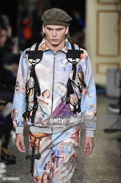 Jordan Barrett walks the runway at the Moschino Autumn Winter 2017 fashion show during Milan Menswear Fashion Week on January 14 2017 in Milan Italy