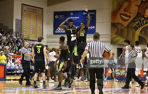 Jordan Bell and Chris Boucher of the Oregon Ducks celebrate during a break in the action in the second half of the Maui Invitational NCAA college...