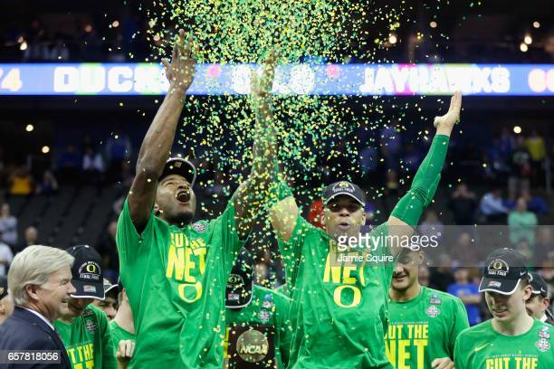 Jordan Bell and Dillon Brooks of the Oregon Ducks celebrate after defeating the Kansas Jayhawks 7460 during the 2017 NCAA Men's Basketball Tournament...