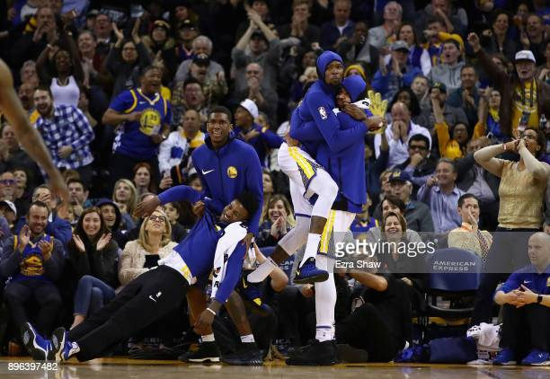 Jordan Bell Kevon Looney Kevin Durant and JaVale McGee of the Golden State Warriors celebrate after the Warriors made a basket against the Memphis...