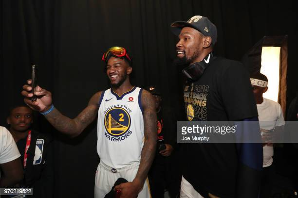 OH Jordan Bell of the Golden State Warriors and Kevin Durant of the Golden State Warriors talk during postgame portraits after Game Four of the 2018...