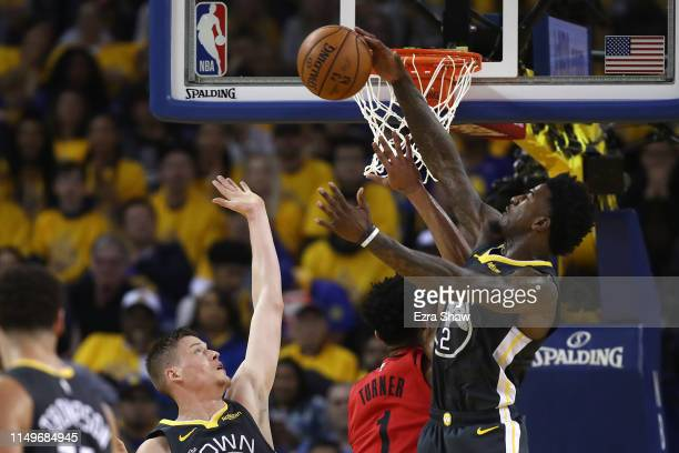 Jordan Bell of the Golden State Warriors blocks a shot against Evan Turner of the Portland Trail Blazers in game two of the NBA Western Conference...