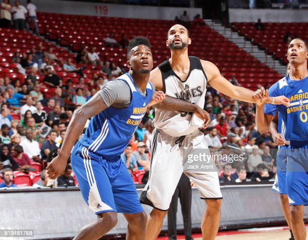 Jordan Bell of the Golden State Warriors boxes out Perry Ellis of the Minnesota Timberwolves during the 2017 Summer League on July 12 2017 at the...