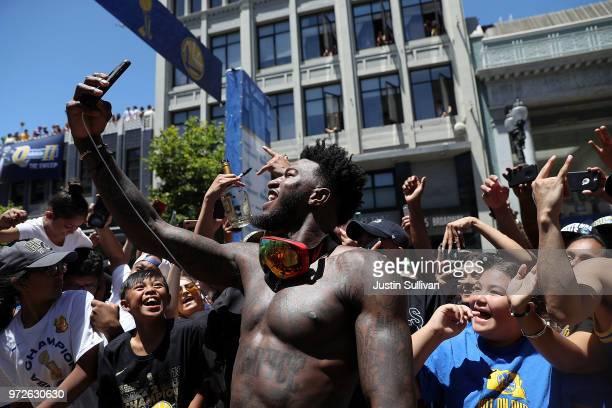 Jordan Bell of the Golden State Warriors celebrates during the Golden State Warriors Victory Parade on June 12 2018 in Oakland California The Golden...