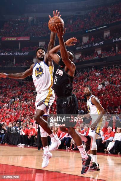 Jordan Bell of the Golden State Warriors contests the shot by James Harden of the Houston Rockets in Game Seven of the Western Conference Finals...