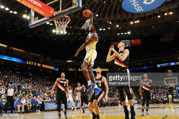 Jordan Bell of the Golden State Warriors drives to the basket against the Portland Trail Blazers on December 11 2017 at ORACLE Arena in Oakland...