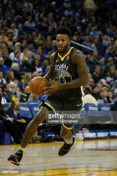Jordan Bell of the Golden State Warriors drives to the basket against the Denver Nuggets at ORACLE Arena on December 23 2017 in Oakland California...