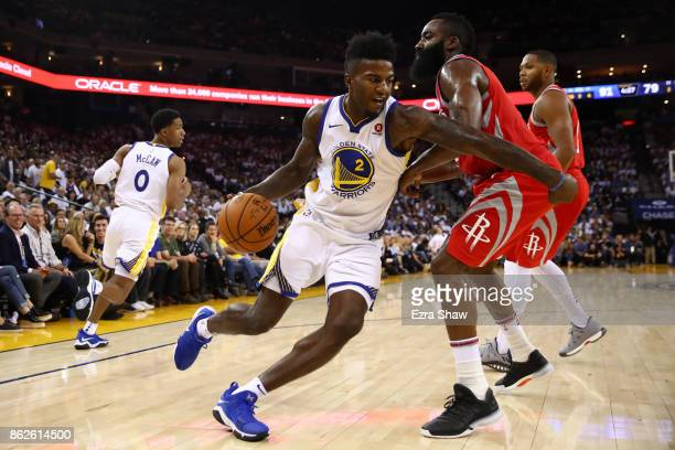 Jordan Bell of the Golden State Warriors drives to the hoop against James Harden of the Houston Rockets during their NBA game at ORACLE Arena on...