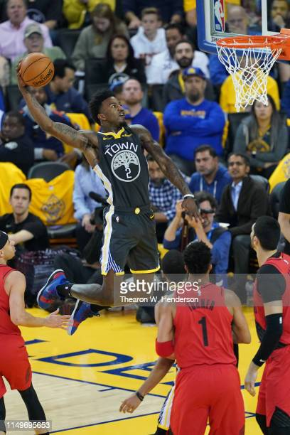 Jordan Bell of the Golden State Warriors dunks the ball against the Portland Trail Blazers in game two of the NBA Western Conference Finals at ORACLE...