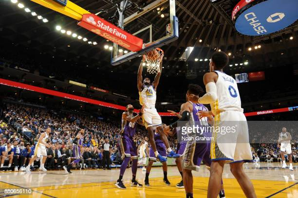 Jordan Bell of the Golden State Warriors dunks the ball against the Sacramento Kings on November 27 2017 at ORACLE Arena in Oakland California NOTE...