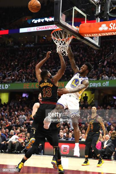 Jordan Bell of the Golden State Warriors fights for a rebound with Tristan Thompson of the Cleveland Cavaliers during Game Three of the 2018 NBA...