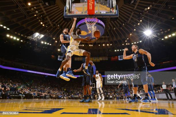 Jordan Bell of the Golden State Warriors goes to the basket against the Dallas Mavericks on December 14 2017 at ORACLE Arena in Oakland California...