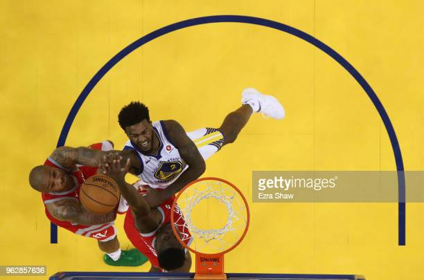 Jordan Bell of the Golden State Warriors goes up for a basket against PJ Tucker and Clint Capela of the Houston Rockets during Game Six of the...